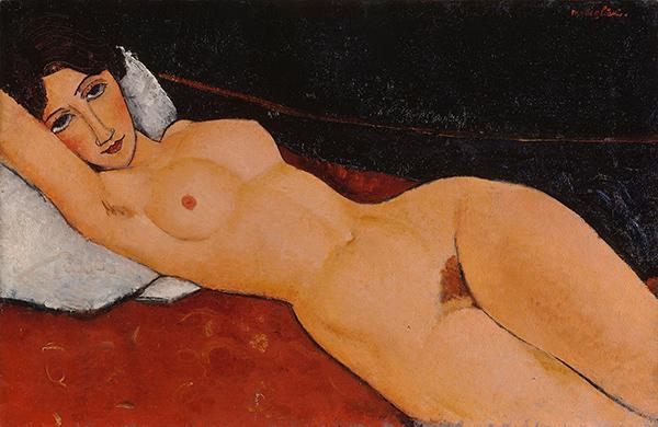 Mujer-desnuda-sobre-almohada
